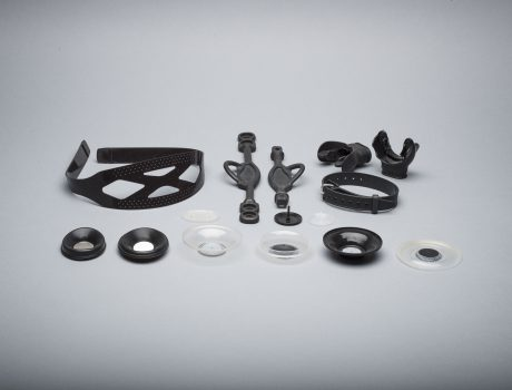 Co-moulding with metal or thermoplastic inserts